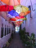 The Alley. Umbrella protects you from sunlights stock images