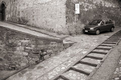 Alley - Umbria. Nice old alley with parked car - Todi, Umbria, Italy Royalty Free Stock Image
