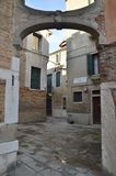Alley in Venice. Arch in a alley  in the city of Venice, Italy Royalty Free Stock Photography