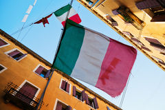 Alley in Venice with Italian flags Royalty Free Stock Photography