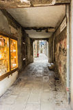 Alley in Venice. A narrow and dirty alley with graffiti in Venice, Italy royalty free stock photos