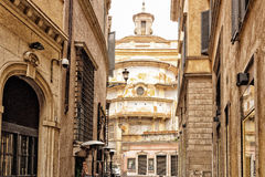 Alleys of Rome: historical buildings and church Stock Photo