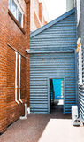 Alleyway Architecture: Blue Accent Wall Stock Photo