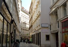 An alleyway in central Vienna, Austria. The Ballgasse, one of central Vienna`s narrow alleyways filled with cafes, bars and specialty shops royalty free stock photography