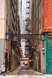 Alleyway in Chicago with pedestrian passing by. Chicago`s alleys make for a cleaner, nicer city.  Pictured is a historic alley with a pedestrian passing by Royalty Free Stock Photography