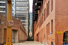 Alleyway in Chicago`s downtown Loop. Signs say No Parking and Truck Entrance. Royalty Free Stock Image