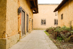 Alleyway between Chinese earthen houses in afternoon Royalty Free Stock Images