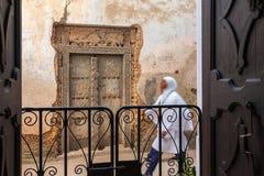 Alleyway door and pedestrian. Royalty Free Stock Photography