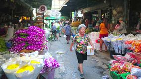 The alleyway of Flower Market, Bangkok, Thailand. BANGKOK, THAILAND - APRIL 23, 2019: The narrow shady alleyway of Pak Khlong Talat flower market with wide range stock video