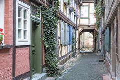 Alleyway with half-timbered houses Stock Images