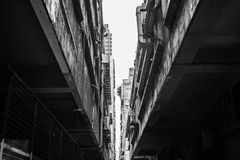 Alleyway in industrial area of Hong Kong. A black and white photo taken in an alleyway in the industrial area in Kwun Tong, Hong Kong Royalty Free Stock Image