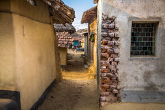 An alleyway that leads into a village in Bankura, India. An alleyway that leads into a village in Bankura, West Bengal, India stock photography