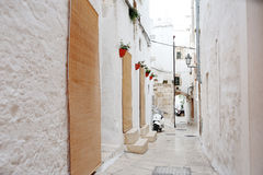 Alleyway in medieval city of Ostuni, Apulia, Italy Stock Photography