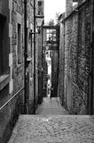 Alleyway in Old Edinburgh. A cobbled alleyway with traditional lanterns in the Old Town of Edinburgh, a UNESCO WH Site Royalty Free Stock Photo