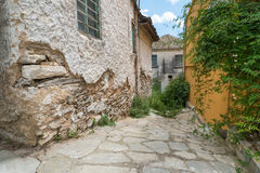 Alleyway in an old Greek town. Royalty Free Stock Photo