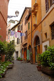 Alleyway in Rome, Italy. Alleyway between colorful houses in Rome, Italy stock images