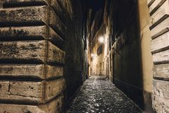 Alleyway in Rome at night. Narrow alleyway in Rome at night. Mystery atmosphere Royalty Free Stock Photography