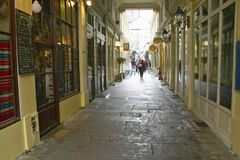 Alleyway of shops and restaurants, Paris, France Stock Photos