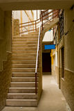 Alleyway with stairs up. Blue sign, fresh, clean Stock Image