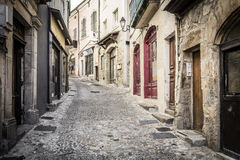 Alleyway in the town of Aubenas, France Stock Images