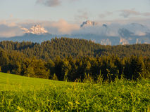 Allgaeu landscape peaks in the clouds near Forggensee Royalty Free Stock Photography