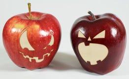 Allhelgonaafton - äpplen med framsidor Royaltyfri Fotografi