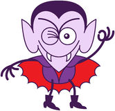 Allhelgonaafton Dracula som blinkar och gör ett reko tecken Royaltyfria Foton