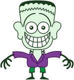Allhelgonaafton Frankenstein som grinar, medan känna sig generat Arkivfoton