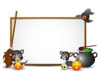 Allhelgonaaftontecken med häxahatten, häxakvasten, katten, kitteln och pumpa Royaltyfri Bild