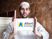Alliant Energy logo. Logo of Alliant Energy on samsung tablet holded by arab muslim man. Alliant Energy Corporation is a public utility holding company Stock Photos