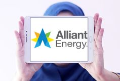 Alliant Energy logo. Logo of Alliant Energy on samsung tablet holded by arab muslim woman. Alliant Energy Corporation is a public utility holding company Royalty Free Stock Image
