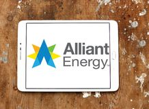 Alliant Energy logo. Logo of Alliant Energy on samsung tablet on wooden background. Alliant Energy Corporation is a public utility holding company Stock Images