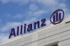 Allianz. Logo sign on blue sky background Stock Images