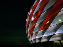 Allianz Arena FC Bayern München Munich. Football Stadium in Munich at night, shining in the colors of FC Bayern Munich. Building with Modern architecture and stock images