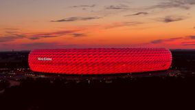 Allianz Arena, illuminated, Munich, Upper Bavaria, Bavaria. Famous football stadium Allianz Arena in Munich, Bavaria, Germany, Europe stock footage