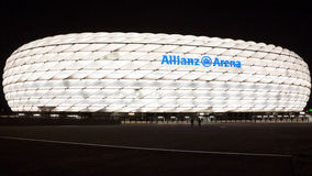 Allianz Arena illuminated at night. The Allianz Arena is a football stadium in the north of Munich, Bavaria, Germany. It is the home of the FC Bayern Munich royalty free stock photos