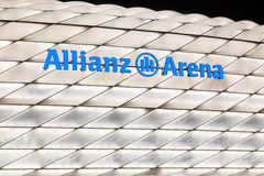 Allianz Arena illuminated at night. Stock Photos