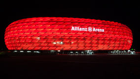 Allianz Arena illuminated at night. The Allianz Arena is a football stadium in the north of Munich, Bavaria, Germany. It is the home of the FC Bayern Munich stock photos