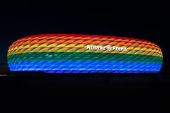 Allianz Arena illuminated in rainbow light on Christopher Street Day. MUNICH, GERMANY - 9 JULY 2016: Allianz Arena illuminated in rainbow light on Christopher royalty free stock images