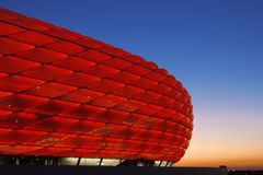 Allianz Arena Munich. Illuminated allianz arena in Munich at sunset , the allianz arena is a modern football stadium Royalty Free Stock Photography