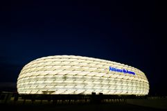 Allianz Arena in Munich at night in white. Allianz Arena in white, night photo of the famous stadium in Munich, Germany royalty free stock images