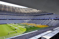 Allianz Arena Stadium. Greatness and impressiveness of Allianz Arena stadium -the official playground of FC Bayern Munich. Grass growing machinery on the field stock image