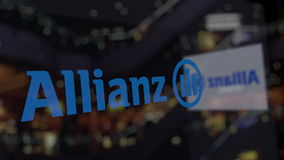 Allianz logo on the glass against blurred business center. Editorial 3D rendering Stock Photos