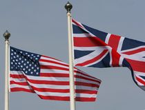 Allied nations. The American Stars and stripes flying from a flagpole next to the Union Jack of Great Britain Stock Photography