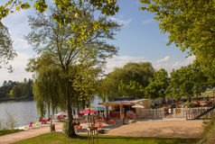 Allier lakeshore and public promenade in Vichy, center of France. View of the Allier lakeshore and public promenade inside a great natural urban park in Vichy Royalty Free Stock Images