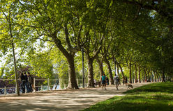 Allier lakeshore and public promenade in Vichy, center of France. View of the Allier lakeshore and public promenade inside a great natural urban park in Vichy Royalty Free Stock Image