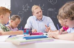 Allievi che imparano per la matematica Fotografie Stock
