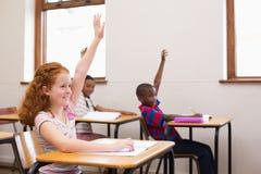 Allievi che sollevano le loro mani durante la classe Fotografia Stock Libera da Diritti