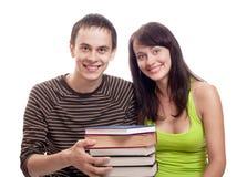 Allievi con i libri isolati su bianco Immagini Stock