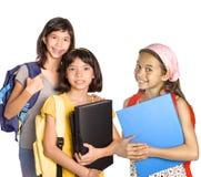 Allievi della ragazza con i libri ed i dispositivi di piegatura Immagine Stock Libera da Diritti